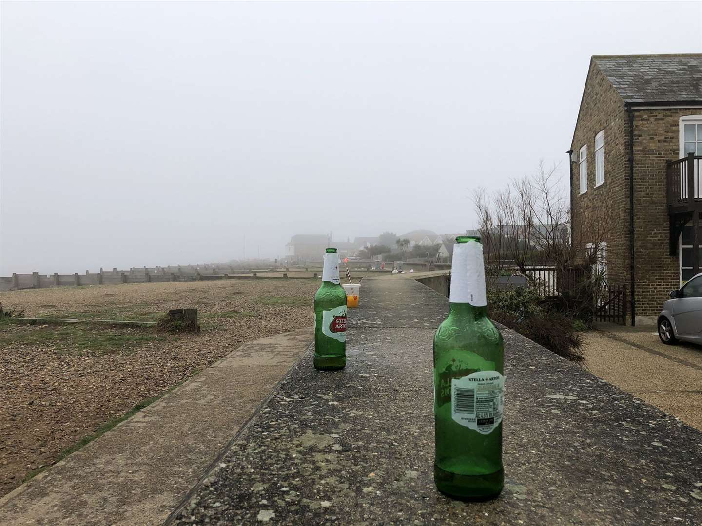 Beer bottles left along the seafront. Picture: David Cramphorn
