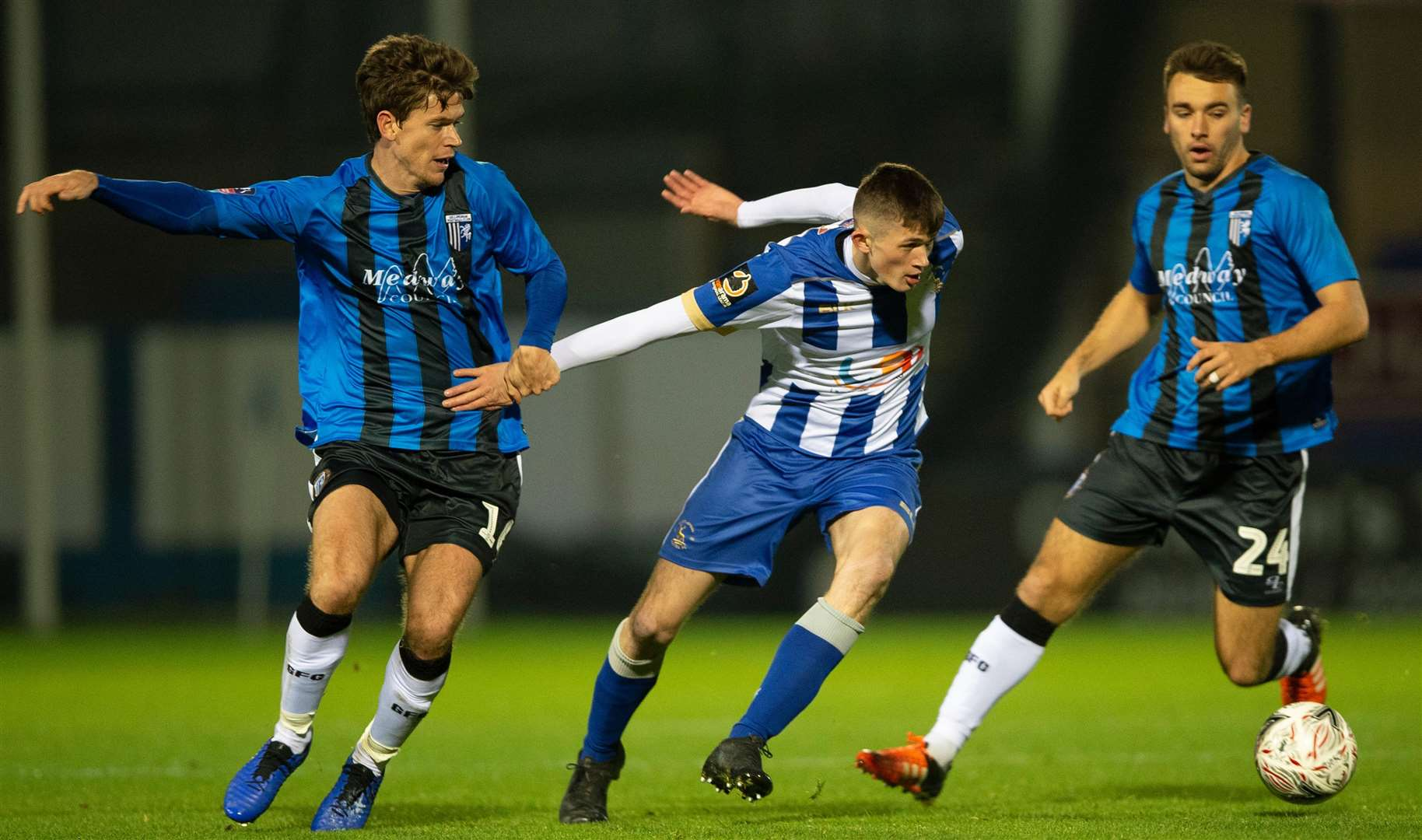 Gillingham's Billy Bingham gets to grips with Tyrone O'Neill. Picture: Ady Kerry