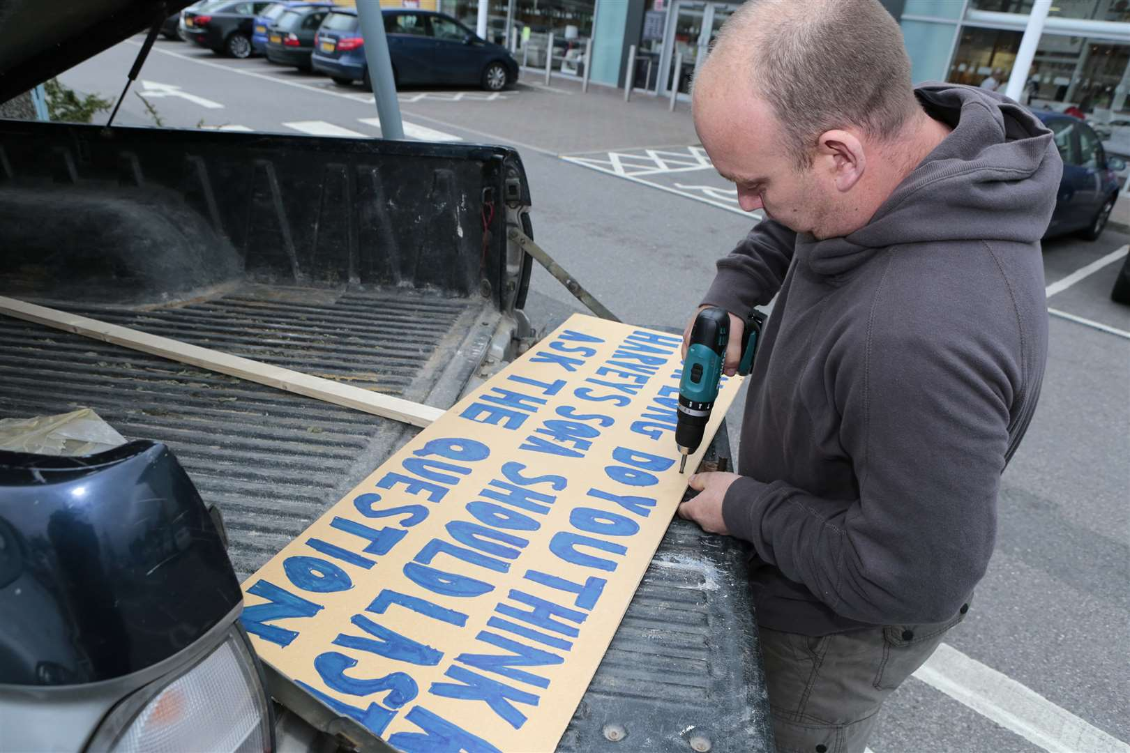 Ian Hayden, from Paddock Wood, staged a protest outside Harveys in Aylesford retail park. Picture by Martin Apps.