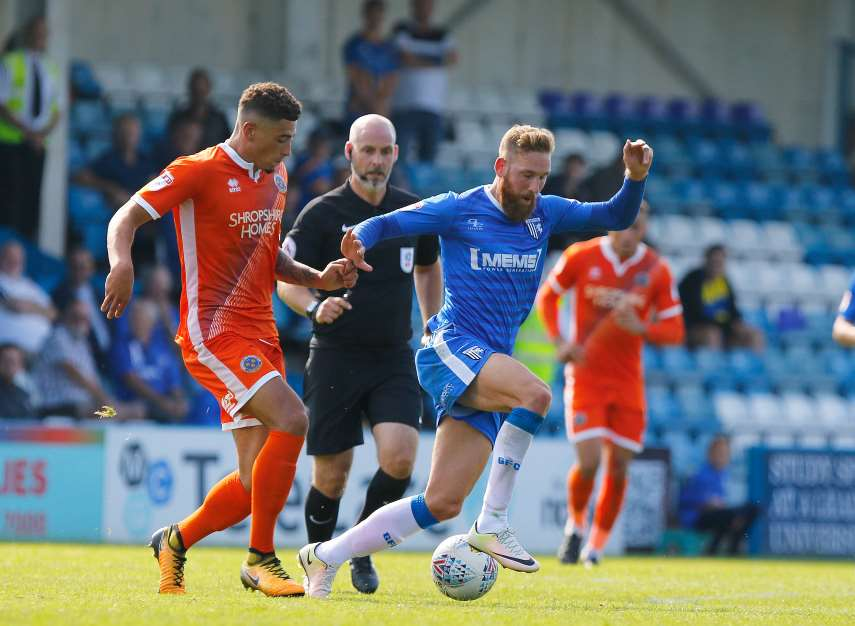 Scott Wagstaff driving forward for Gillingham Picture: Andy Jones