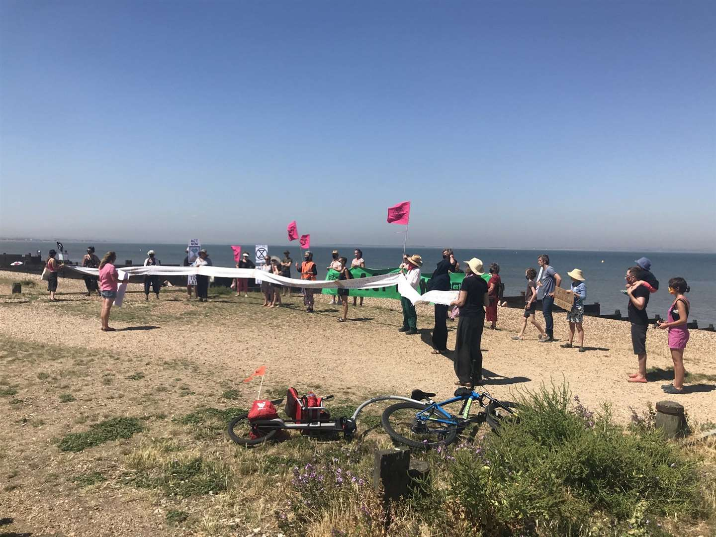 Protestors from Whitstable XR gather on the beach. Picture: Bernadette Fisher / Twitter