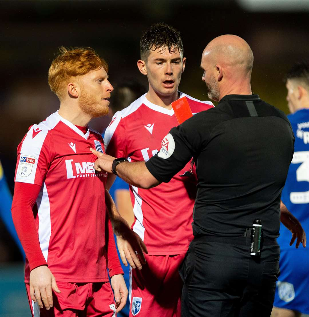 Referee Kevin Johnson pulls out the red card after being confronted by Ben Pringle Picture: Ady Kerry