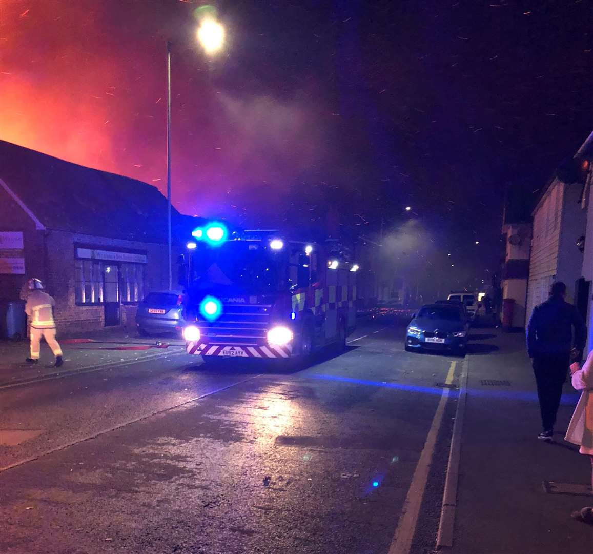 Firefighters arrive to tackle the fire at FJ Williams joinery in London Road, Teynham. Picture: Paul Mercer (5309077)