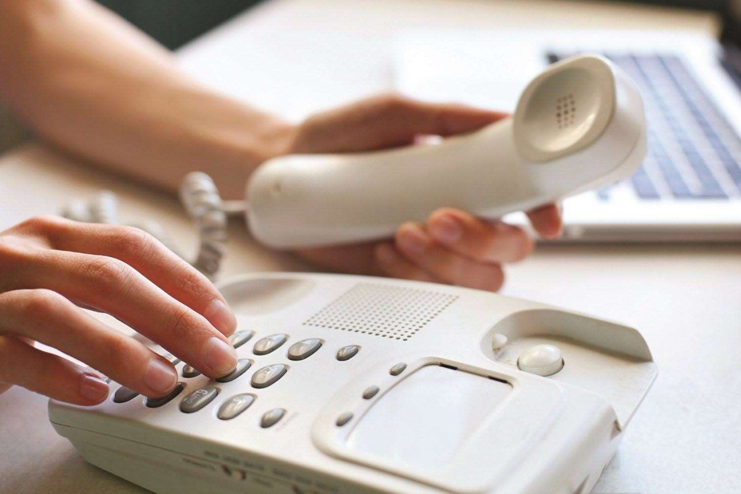 The callers put pressure on people over the phone. Stock photo