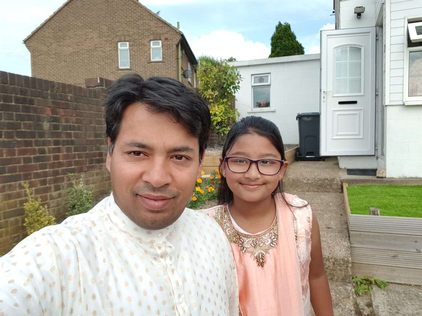 Mizanor Rahman with his youngest daughter