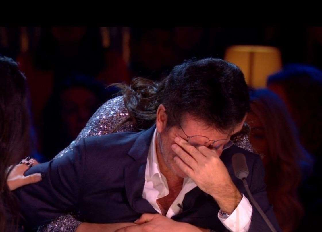 Simon Cowell broke down on the X Factor final after watching the performance. Pic: ITV (23130813)