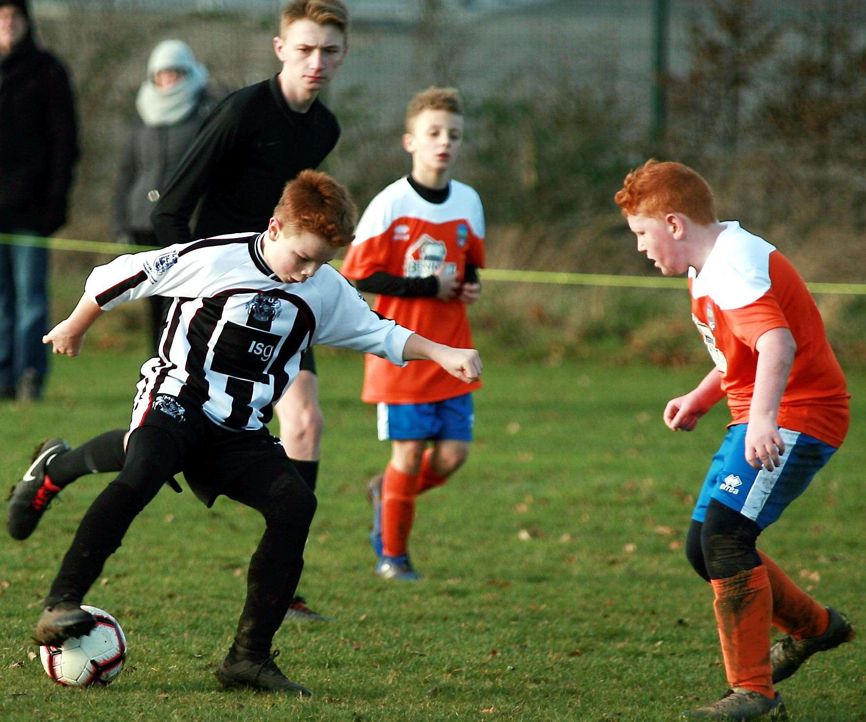 Milton and Fulston United Zebras under-12s on the ball against Cuxton 91 Dynamos under-12s. Picture: Phil Lee FM26563364