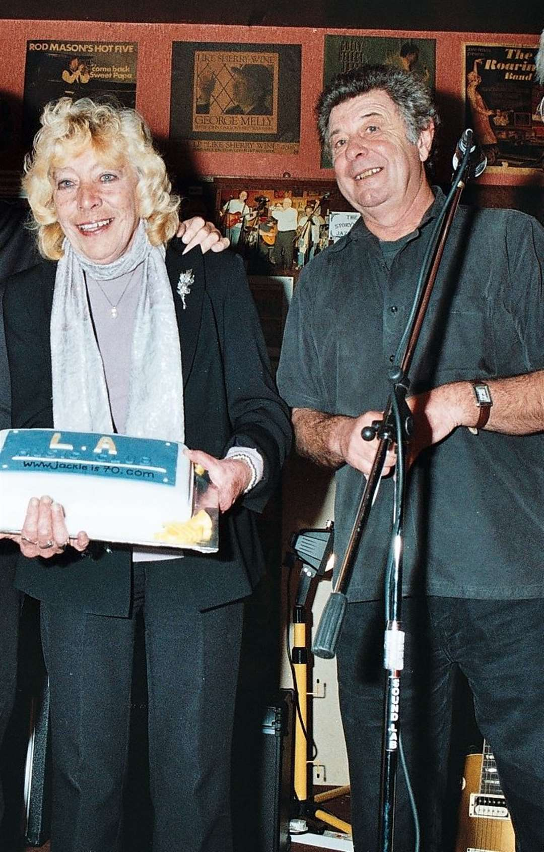 Mrs Bowles on her 70th birthday in 2009 with musician Mick Morris. Picture provided by Mick Morris