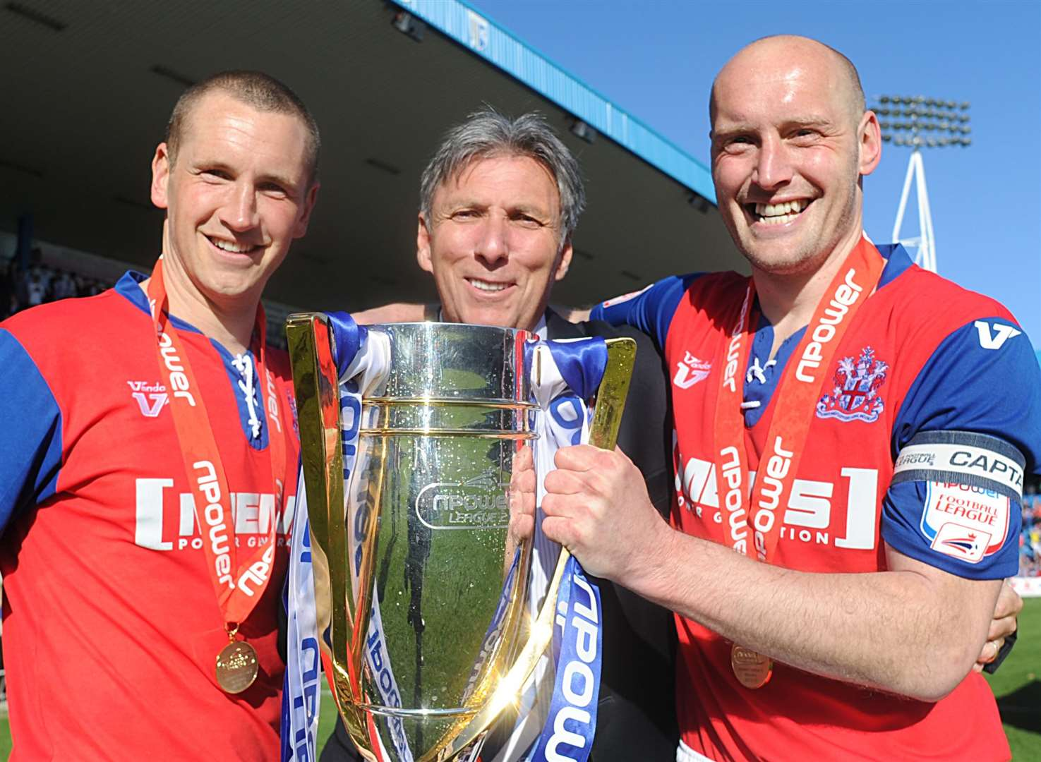 Happier times as Michael Anderson celebrates Gills winning the League 2 title in 2012/13 with Andy Frampton and Adam Barrett. Picture: Barry Goodwin