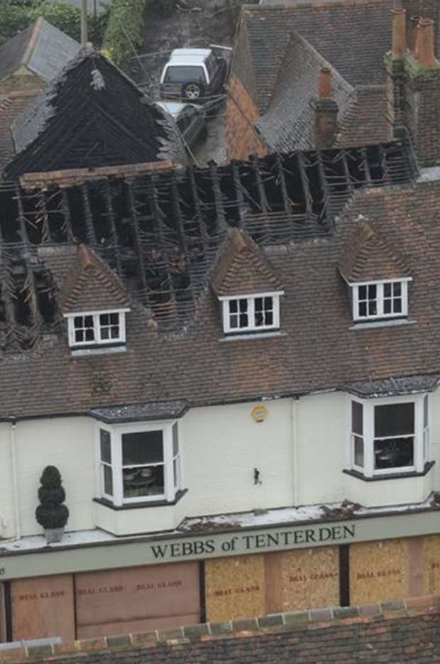 The badly-damaged roof of Webbs of Tenterden & Webbs of Tenterden owners vow to rise from ashes after huge blaze ...