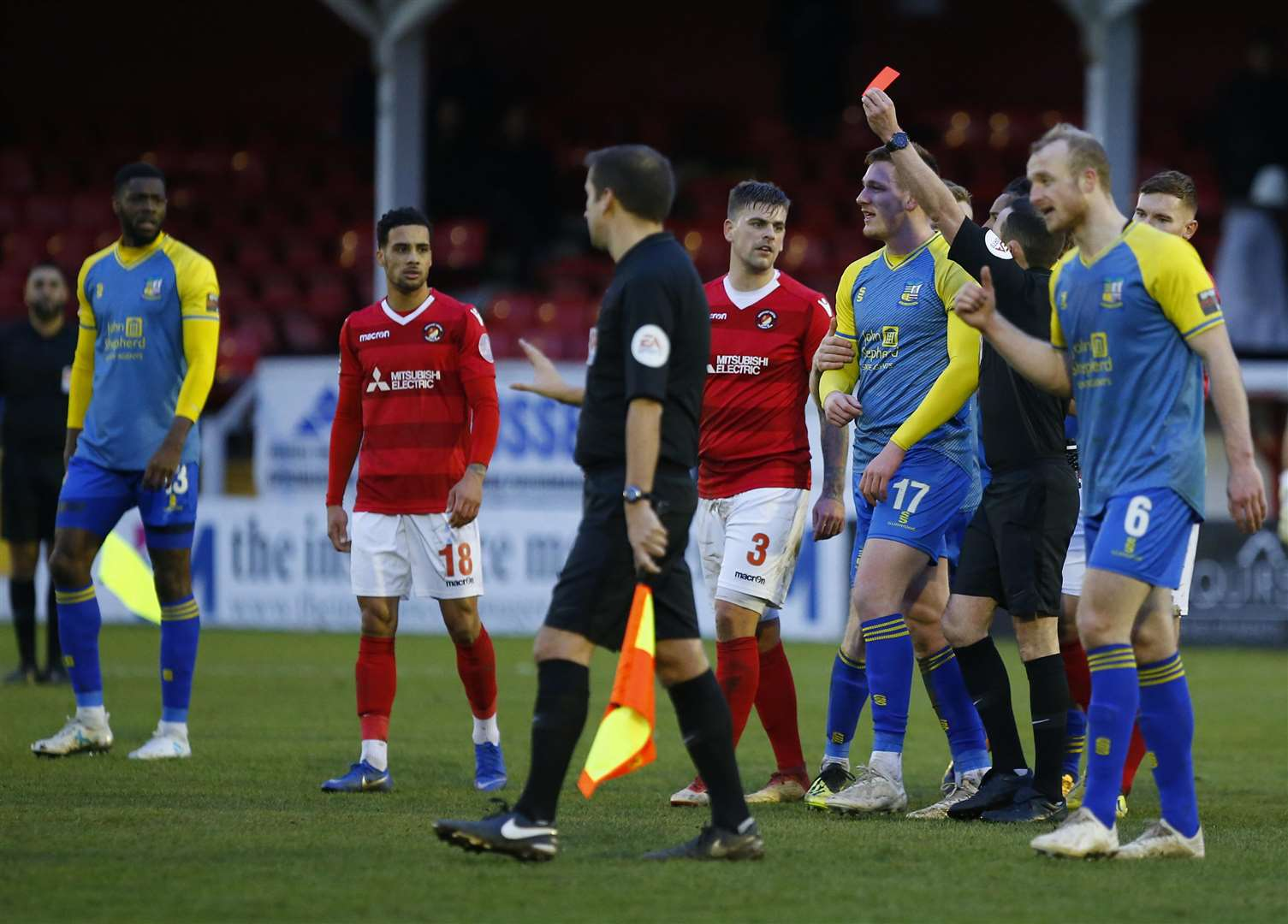 Referee Peter Gibbons showed four red cards in stoppage-time Picture: Andy Jones