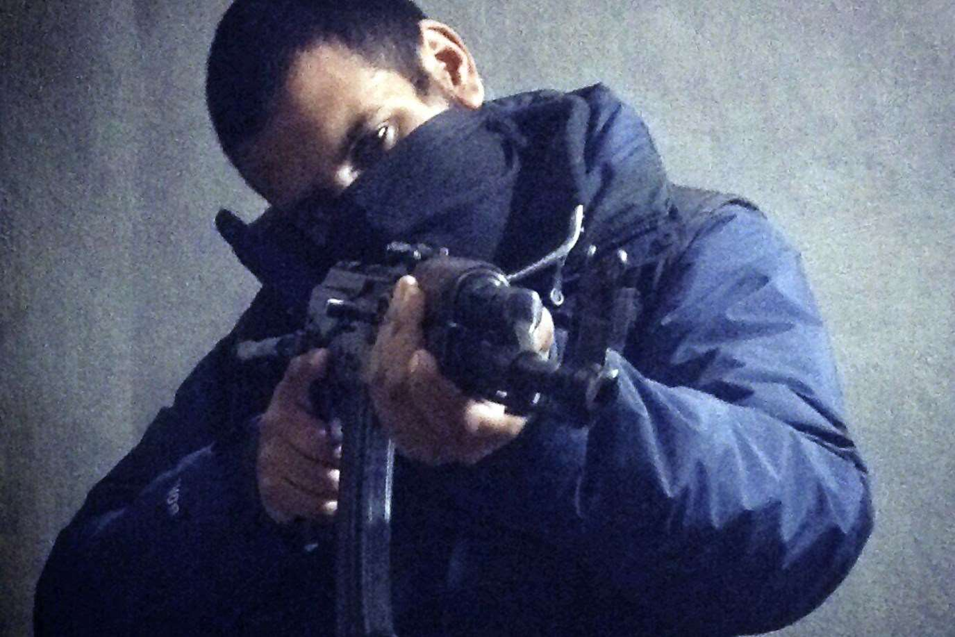 Computer hacker-turned jihadi Junaid Hussain pictured on Twitter with a rifle in his hands.