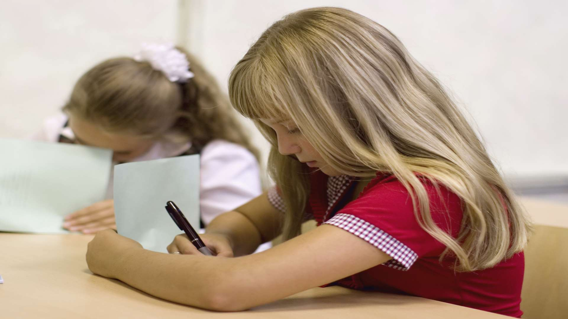 Pupils taking a test. Stock image.
