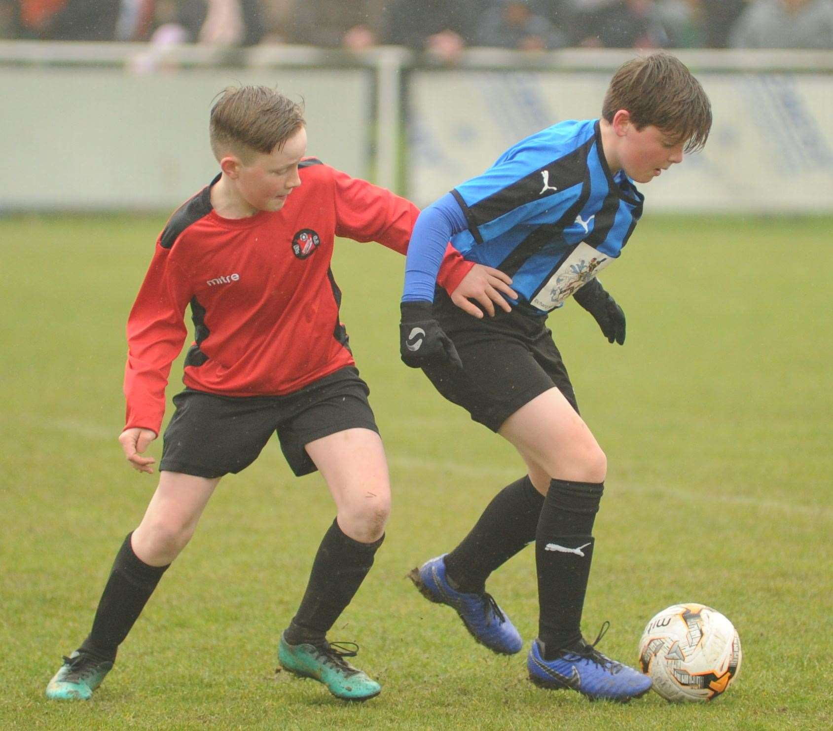 Under-12 John Leeds Trophy finalists Omega 92 Spartans (blue/black) and Rainham Kenilworth battle it out Picture: Steve Crispe
