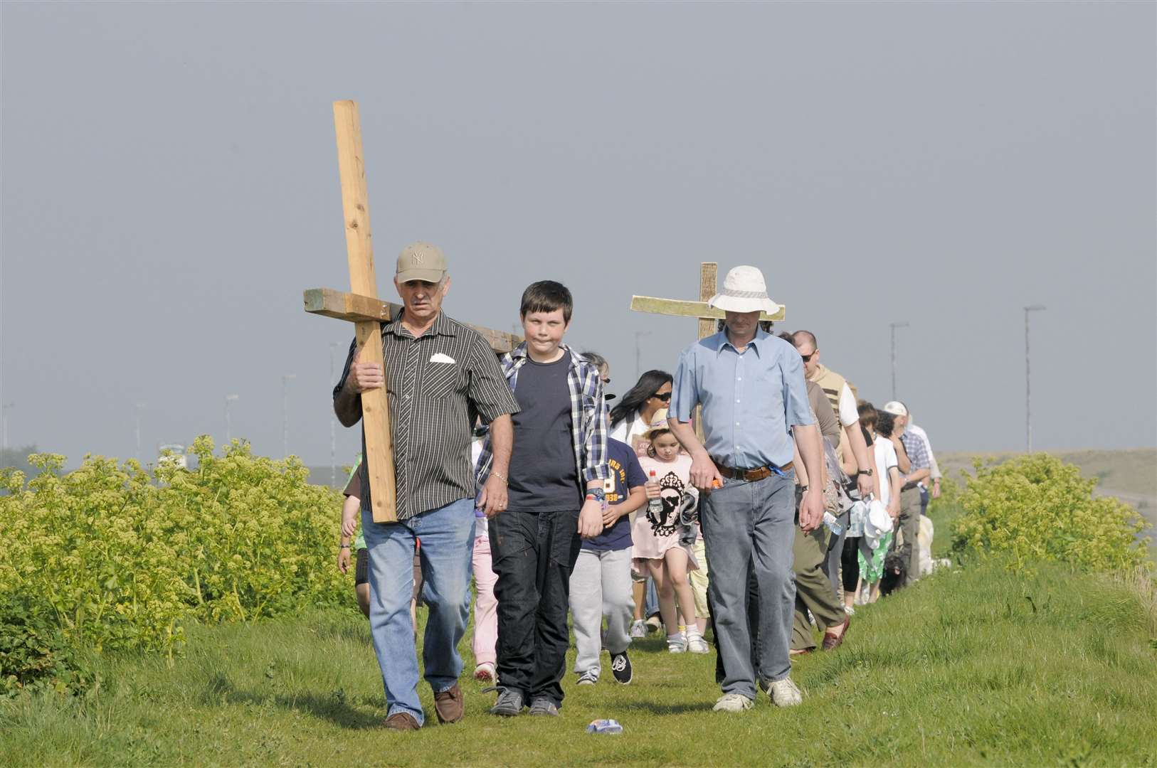The cross from St Henry and Elizabeth, is walked to the site of the annual service in Minster