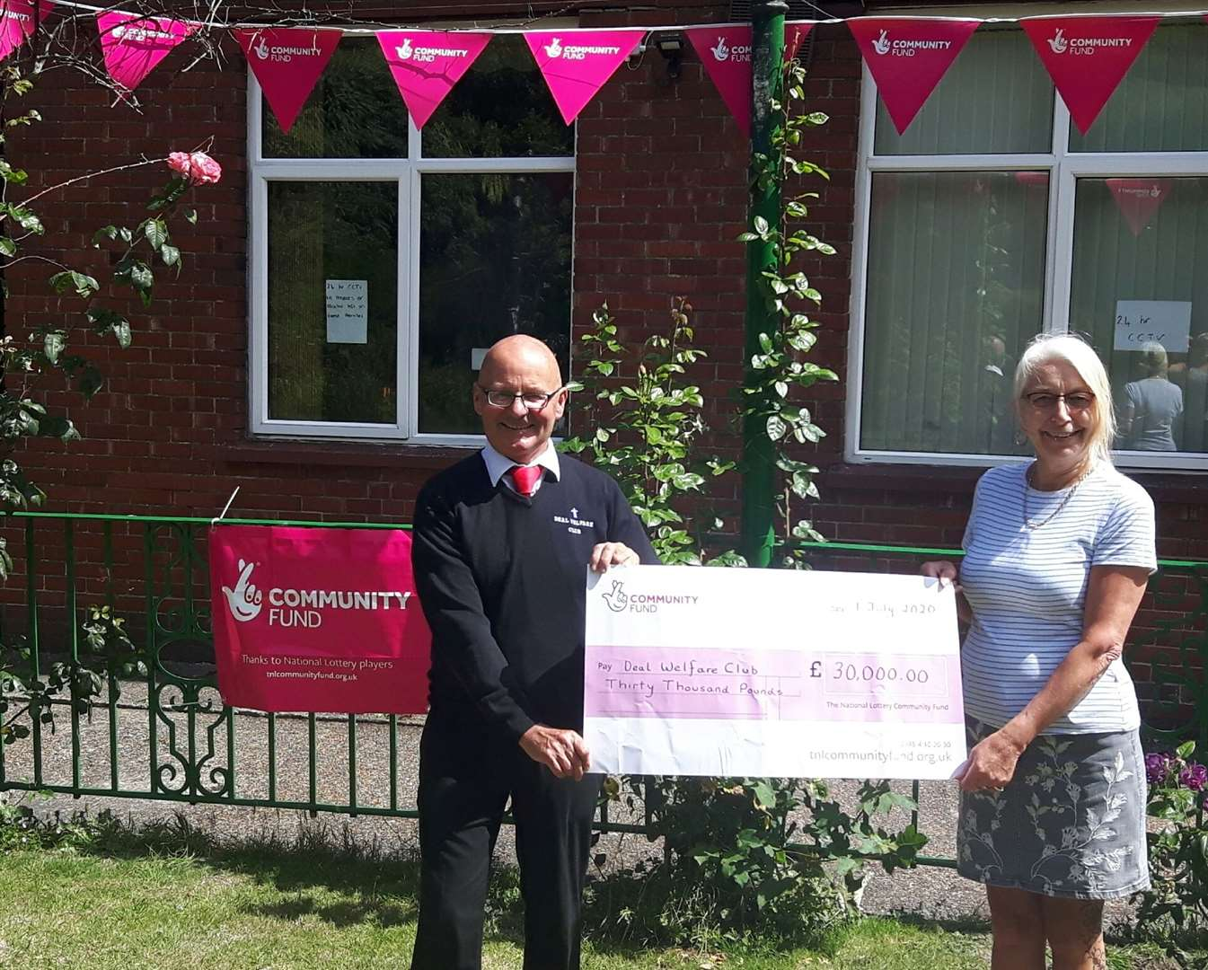 Deal Welfare Club chairman Lee Bowman with treasurer Diane Ashmore with the £30,000 cheque from the National Lottery to pay for meals for financially vulnerable families