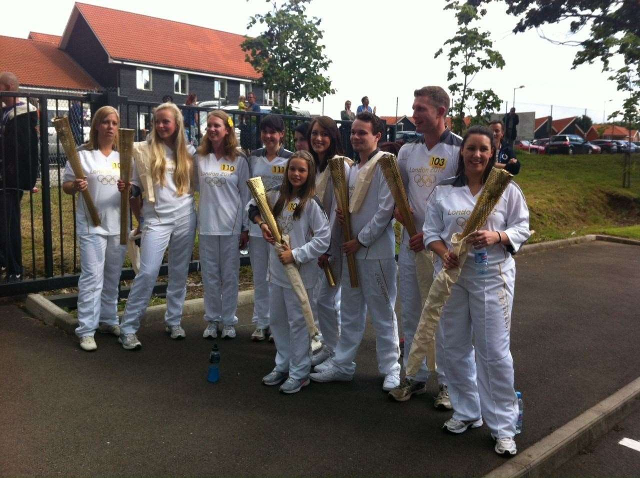 Homewood School pupil Ella Barnes (centre) with fellow Canterbury torchbearers after the relay. Pic: Joanne Barnes
