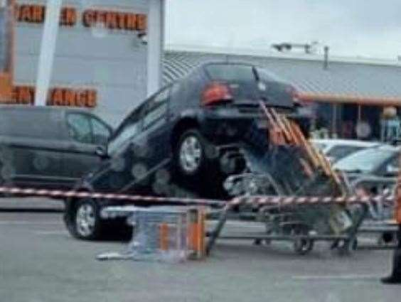 The VW Golf perched precariously in the B&Q car park