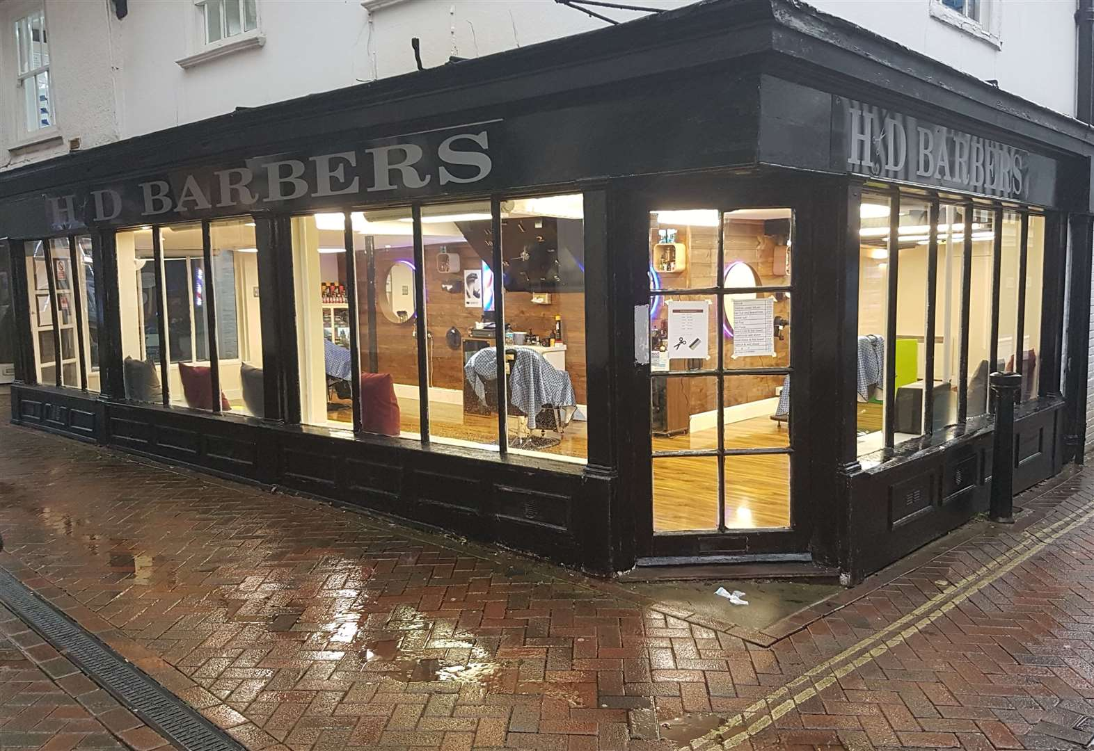 The attack took place outside HD Barbers in Ashford High Street