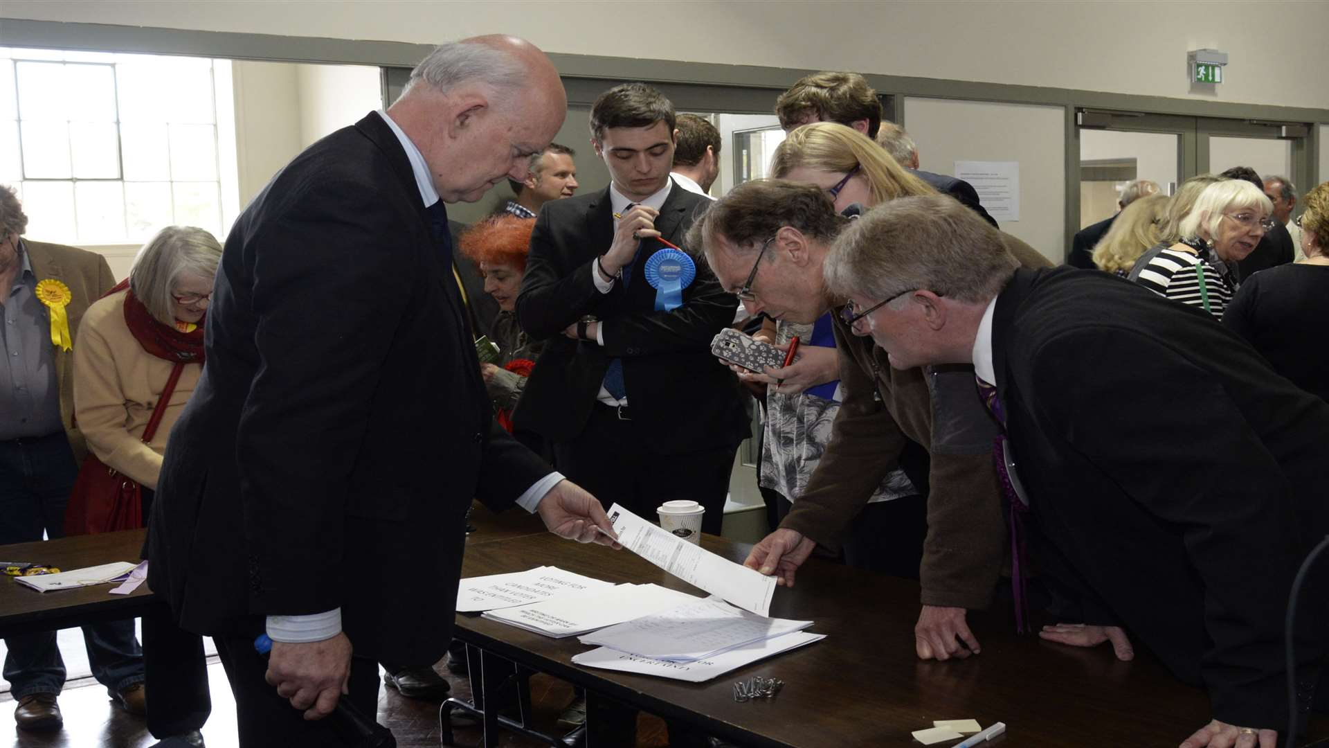 Agentsand candidates gather around returning officer Colin Carmichael