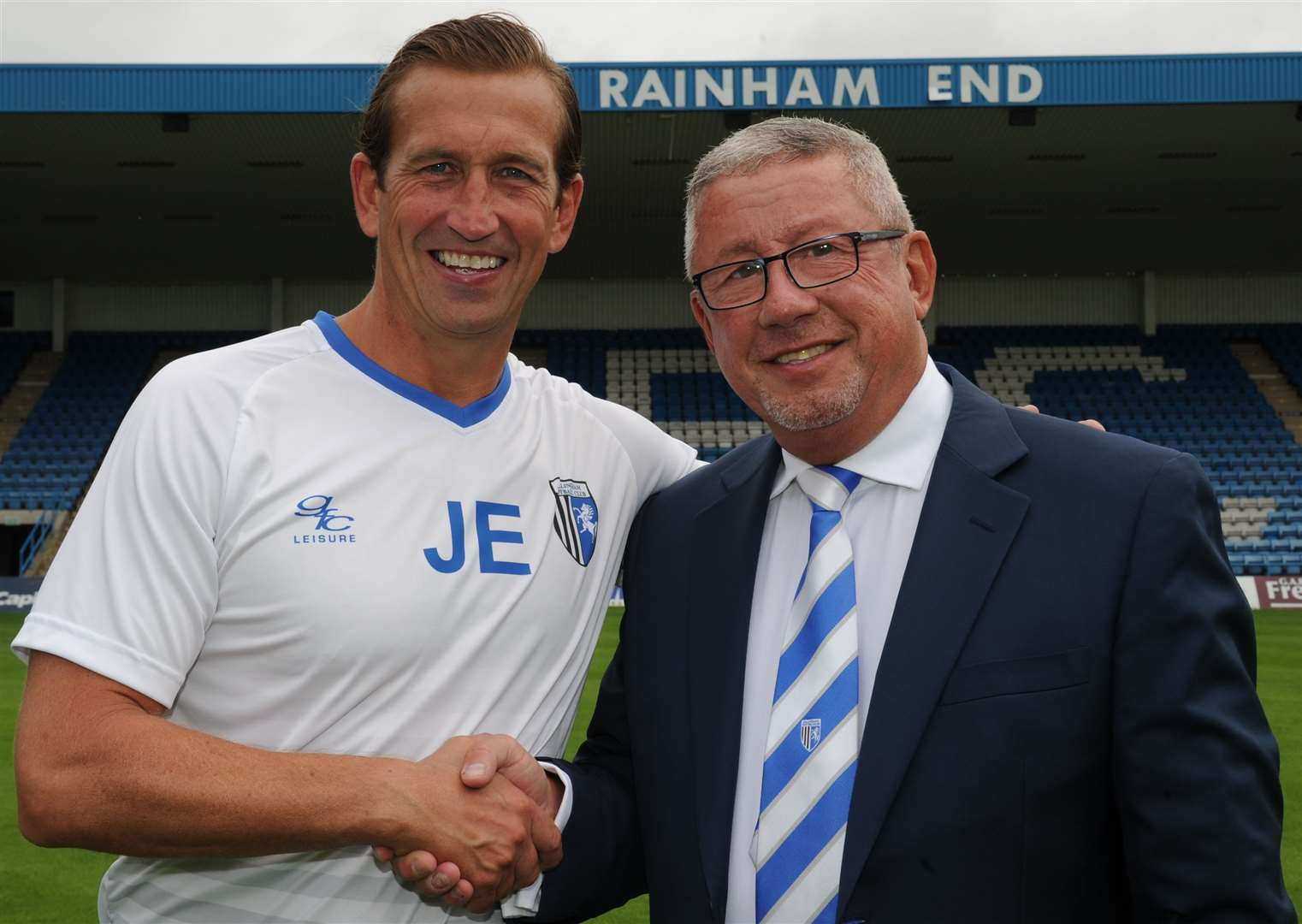 Gillingham chairman Paul Scally pictured with Justin Edinburgh in 2016. Picture: Steve Crispe