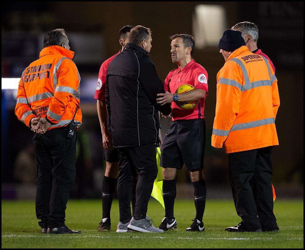 Referee Keith Stroud is confronted by Gillingham manager Steve Lovell Picture: Ady Kerry (6275016)