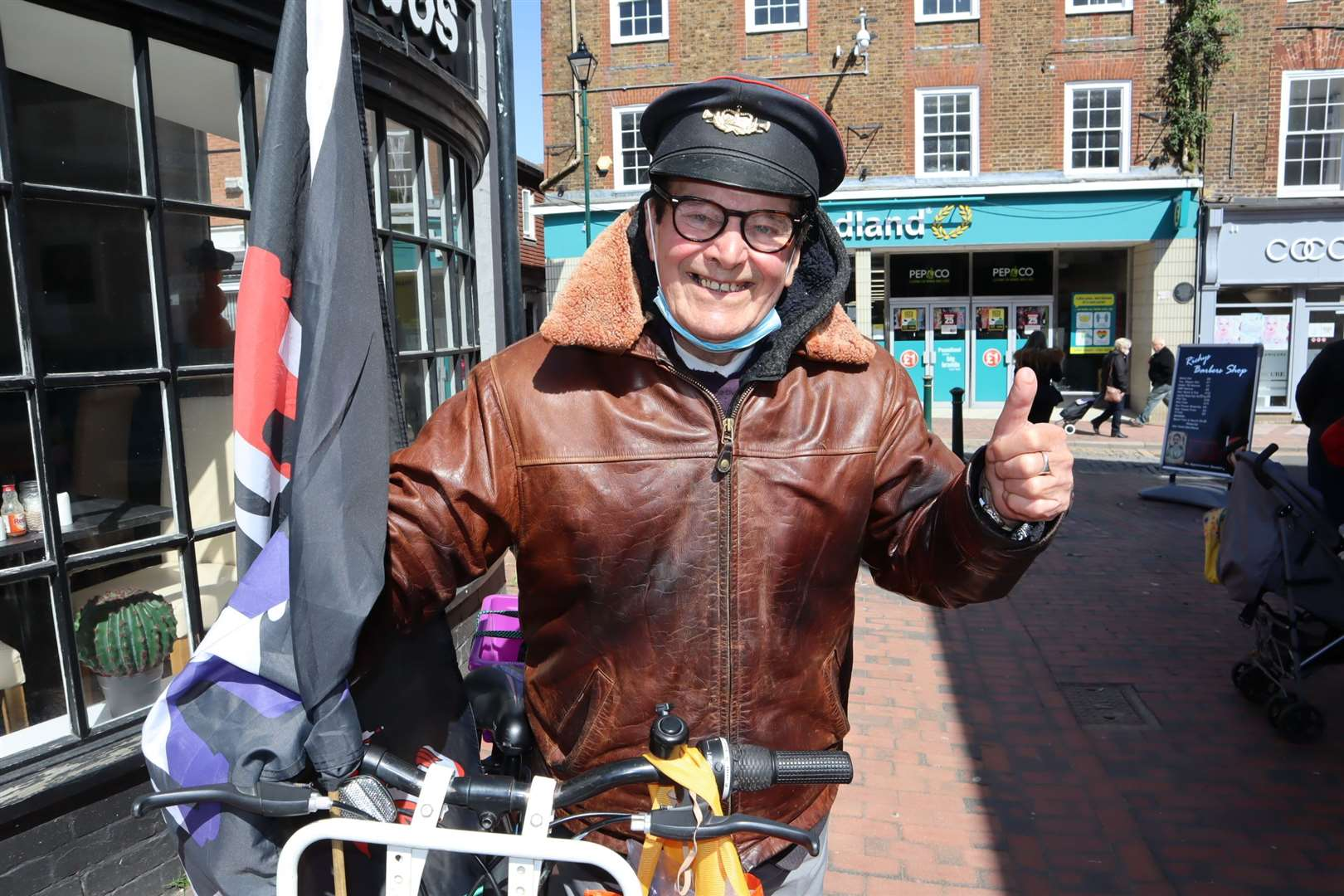 Sittingbourne's 'whistling postman' Dale Howting is smiling again in Roman Square after kind-hearted supporters rallied after he had a day's charity takings stolen from his bike