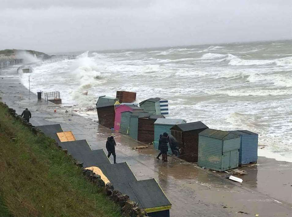 Beach huts washing into the sea. Picture: Ryan Hosking