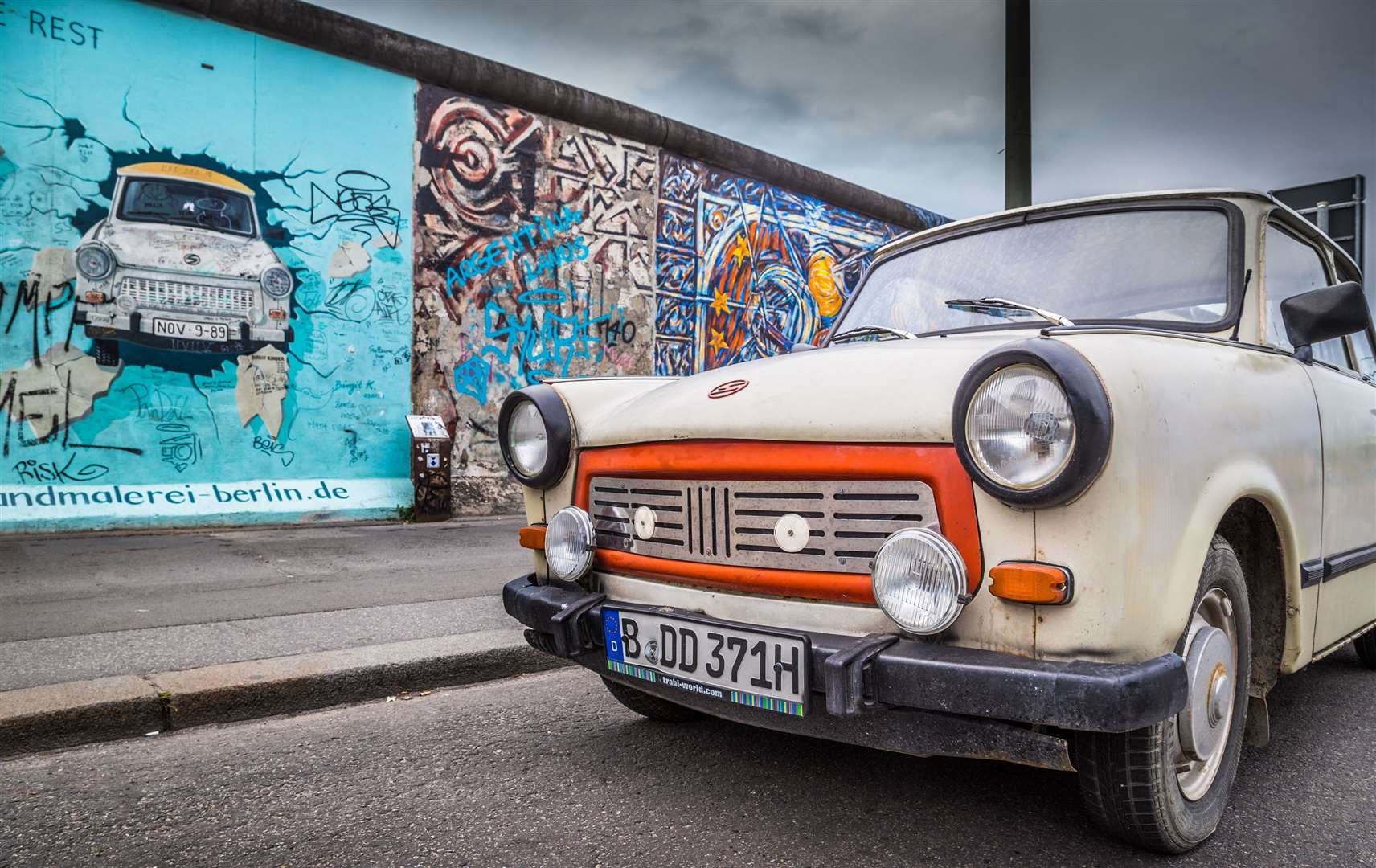 A Trabant car at the Berlin Wall
