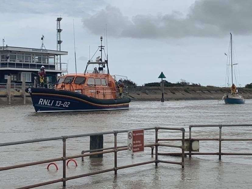 Lifeboat towing the sailing boat to safety in Rye Harbour. Picture: Lisa Adams RNLI