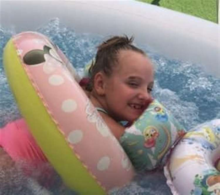 Hannah Taylor, 8, has cerebral palsy and he hydrotherapy pool was stolen from her home in Dartford over night. (15963559)