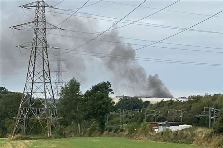 Smoke can be seen billowing from the site. Photo: Barry Goodwin