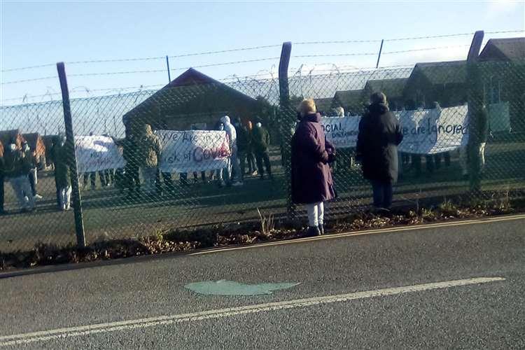 People seeking asylum protesting at Napier Barracks