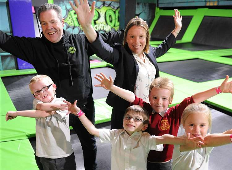 Mark McGill, director of Flip Out Chatham, Chatham MP Tracey Crouch and children from Riverside Primary School, Rainham