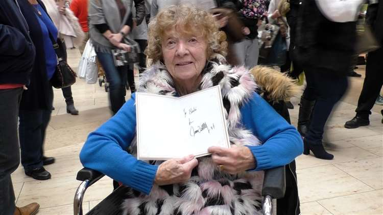 Sheila with the card signed by the snooker champion