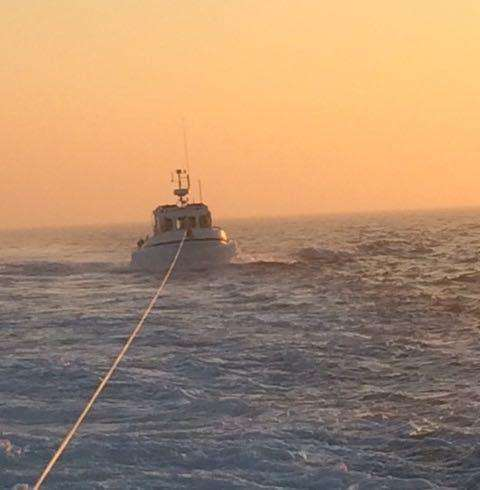 Casualty being towed by Dungeness RNLI lifeboat. Credit: RNLI/Trevor Bunney (7491595)