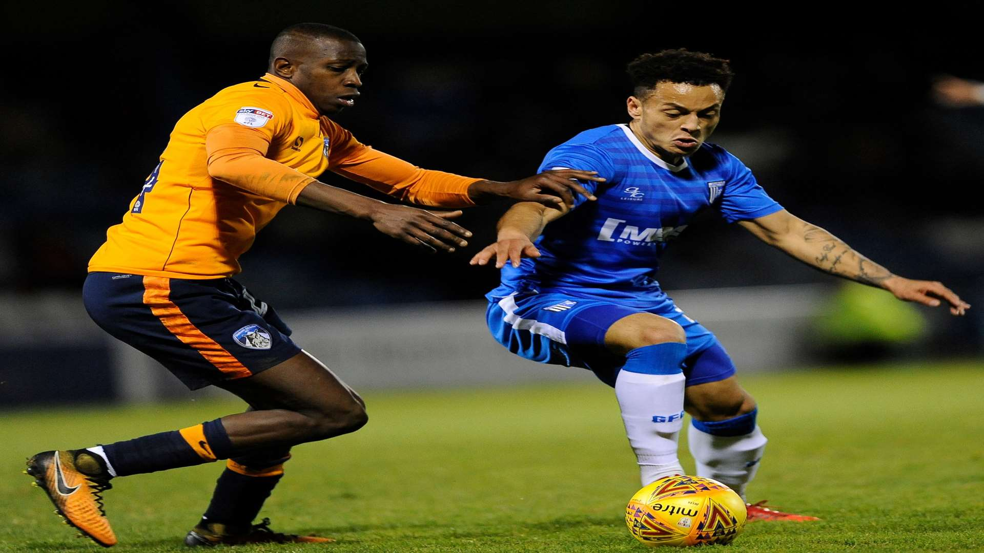 Elliott List holds off Oldham's Ousmane Fane Picture: Ady Kerry