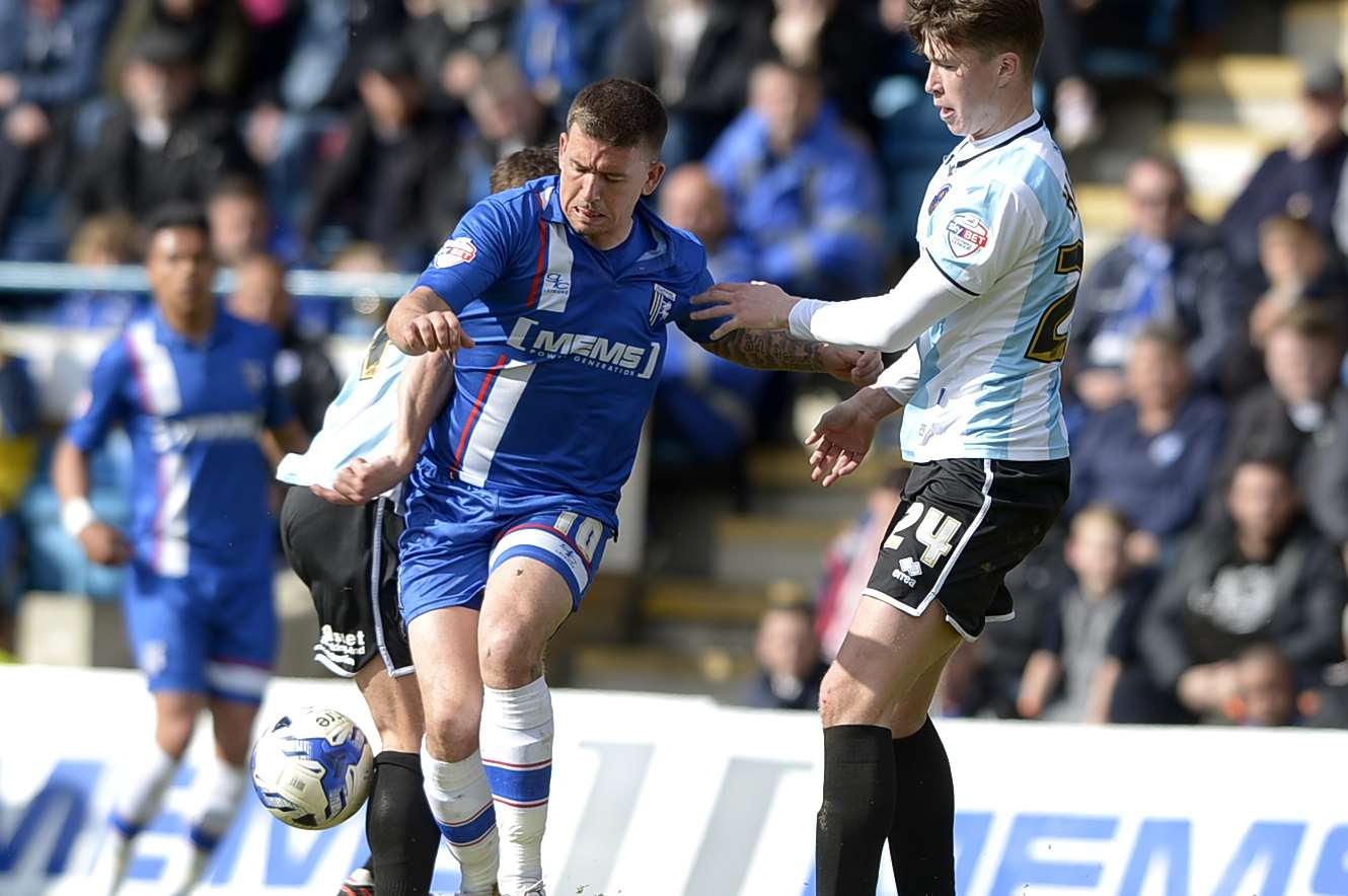 Cody McDonald takes on Shrewsbury's Jack Hendry on Saturday Picture: Barry Goodwin