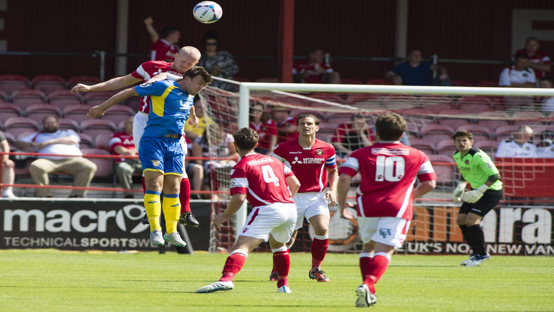Kenny Clark gets up well to win this header Picture: Andy Payton