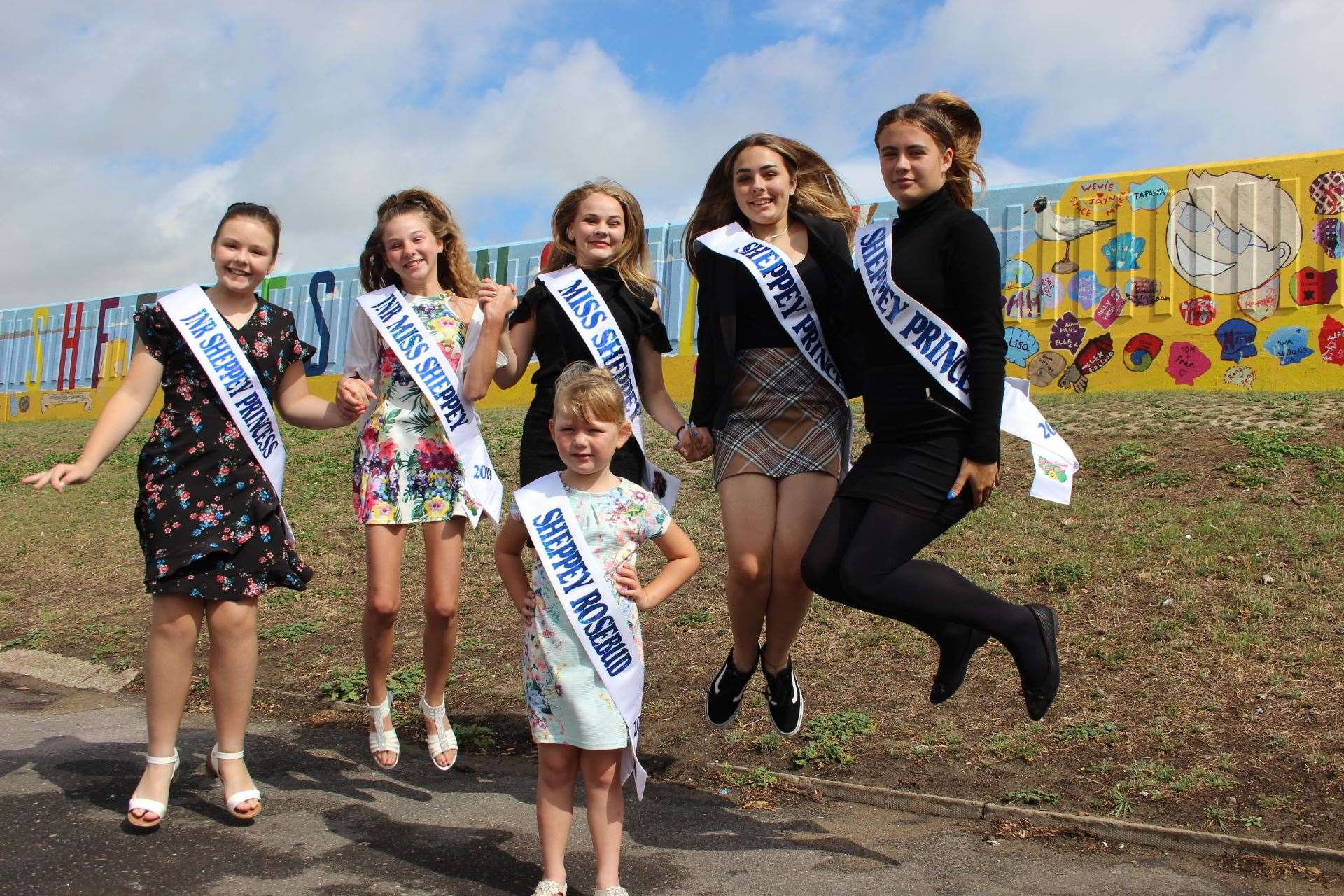 Sheppey carnival girls jumping for joy as they prepare for their big parade on Saturday. From the left, Lois Kidd, 10, Keira Collins-Kiazia, 13, carnival queen Melody Jackson, 15, Darcey Kidd, 14, and Paige Heaton, 14, with Sheppey Rosebud Evie Bowes, 5, in the front. Picture: John Nurden (15016559)