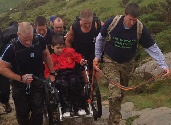 Jake had a little help during the ascent of Snowdon from family and police officers