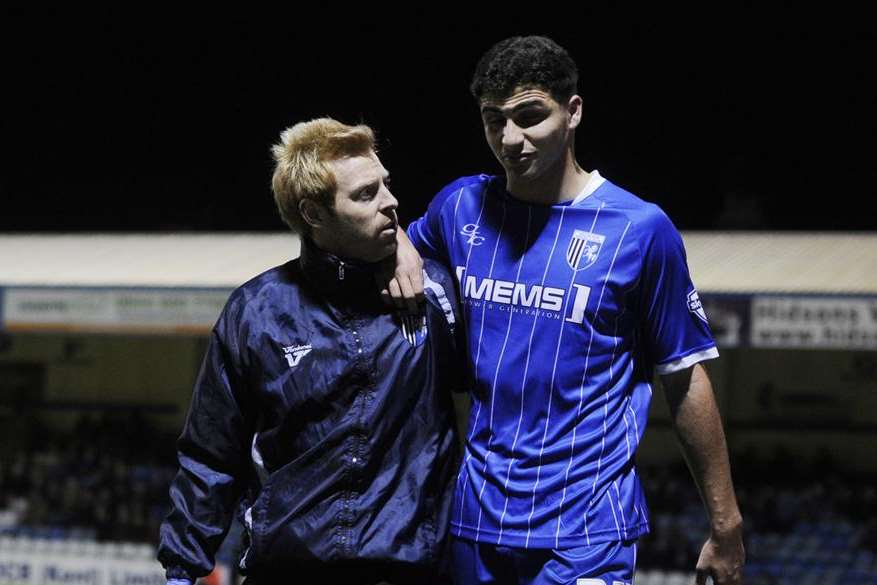Ryan Inniss leaves the field after being injured in his Gills debut against Sheffield United. Picture: Barry Goodwin