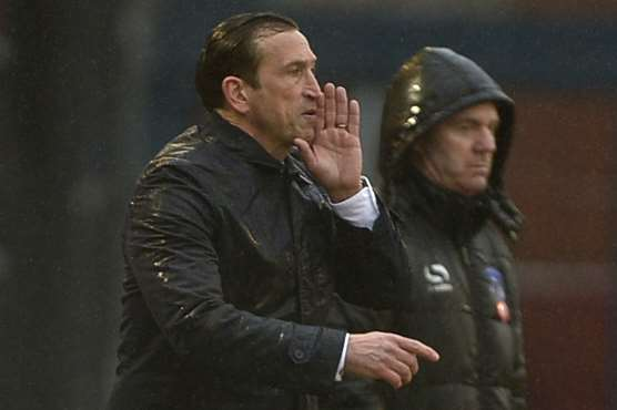 Gills boss Justin Edinburgh on the Boundary Park touchline Picture: Barry Goodwin