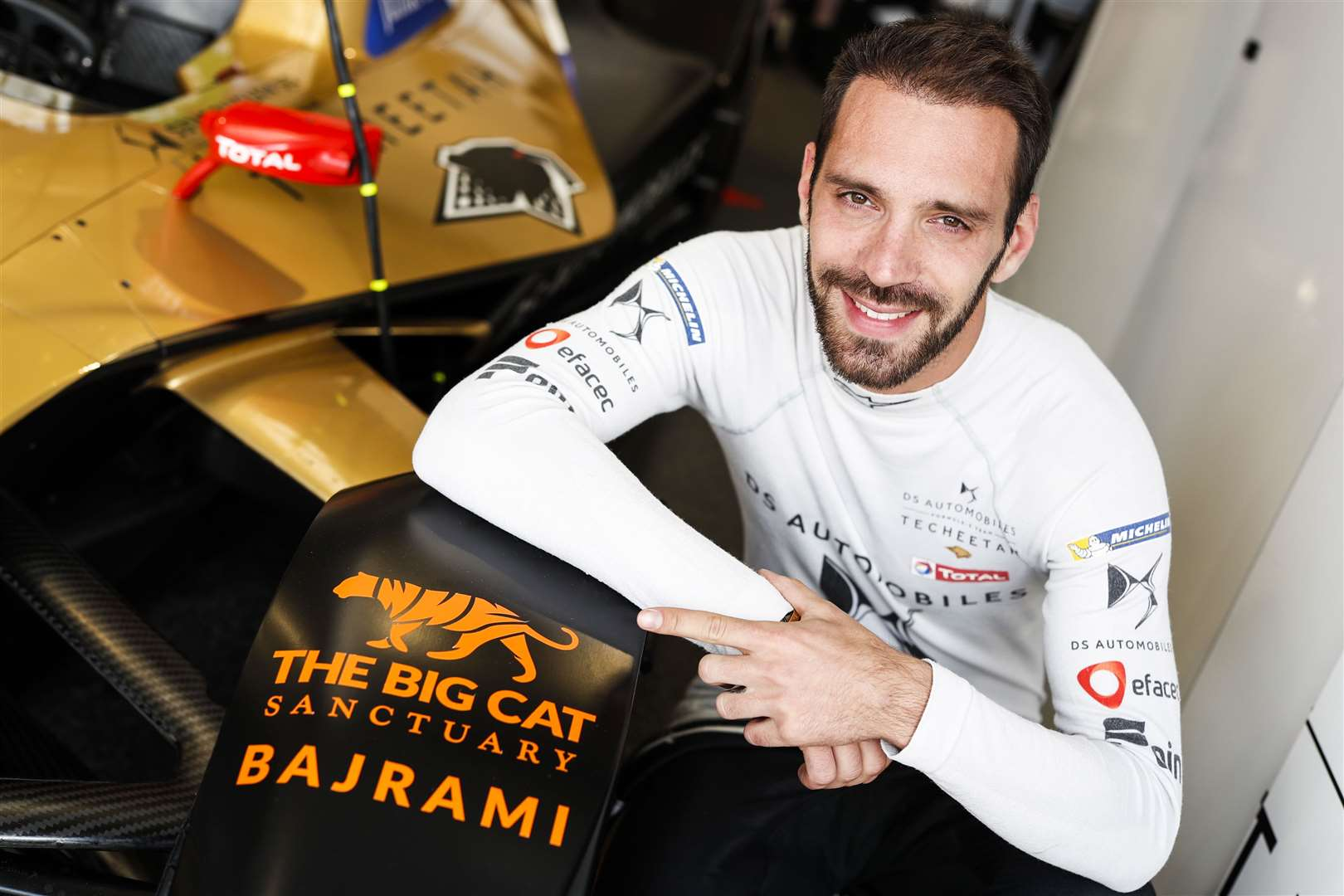 Jean-Eric Vergne poses with the Big Cat Sanctuary logo on his Formula E car