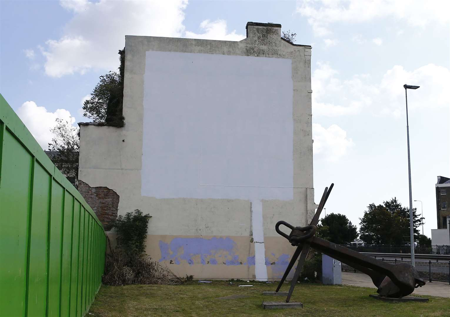 Blank canvas - the mural left with its white covering, photographed just after 11am todayPicture: Matt Bristow.