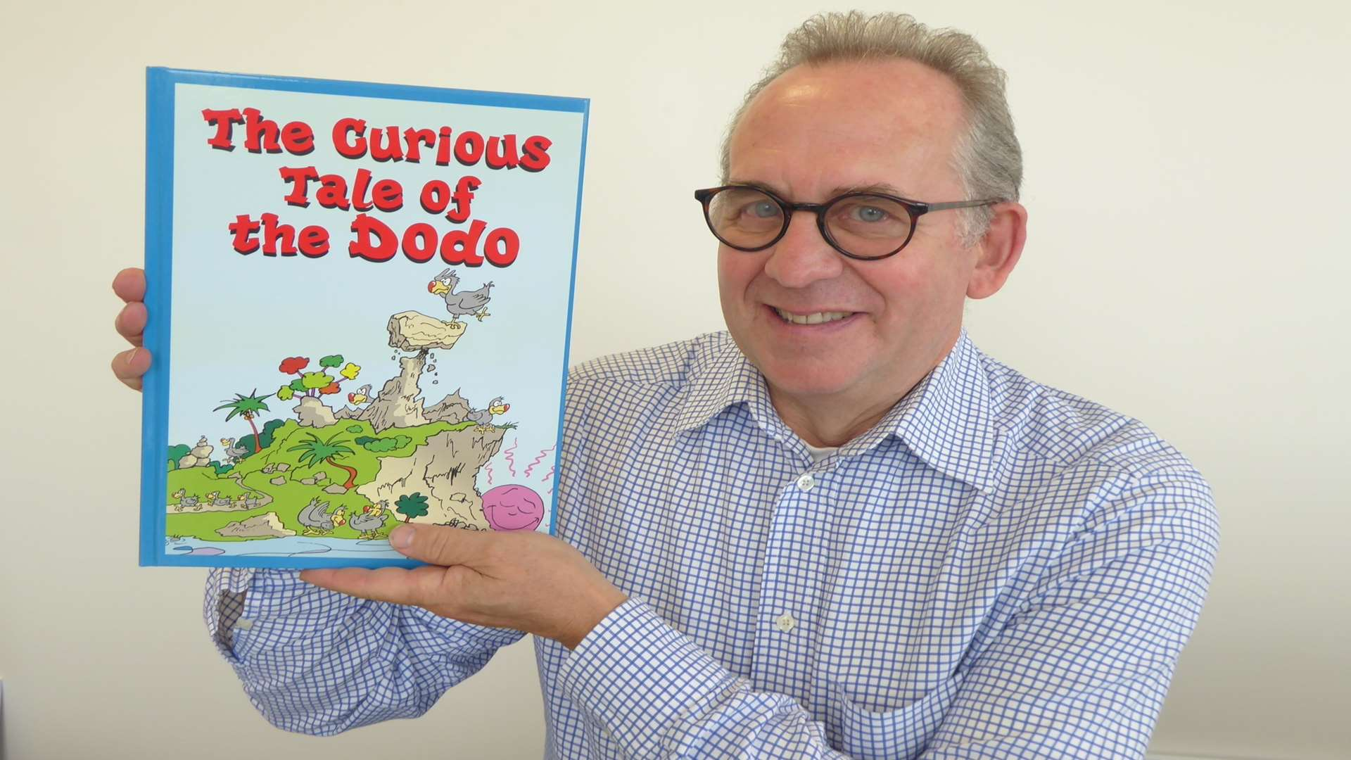 Whitstable author Anthony Cooper, holding his book The Curious Tale of the Dodo, is working with the KM Charity Team to promote World Book Day.