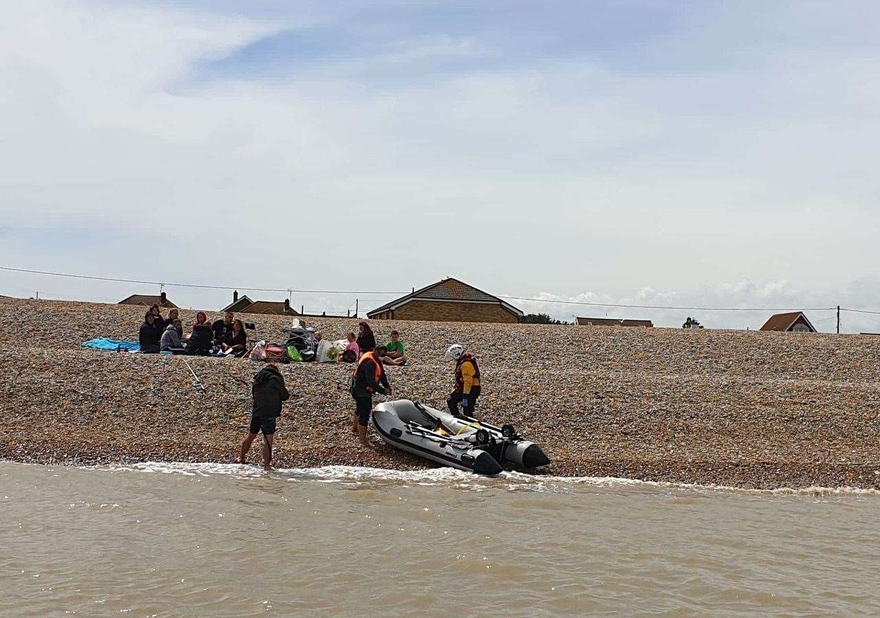 Crew member Heather Crittenden returning the casualties to their family and the safety of the shore. Photo: Peter Leigh