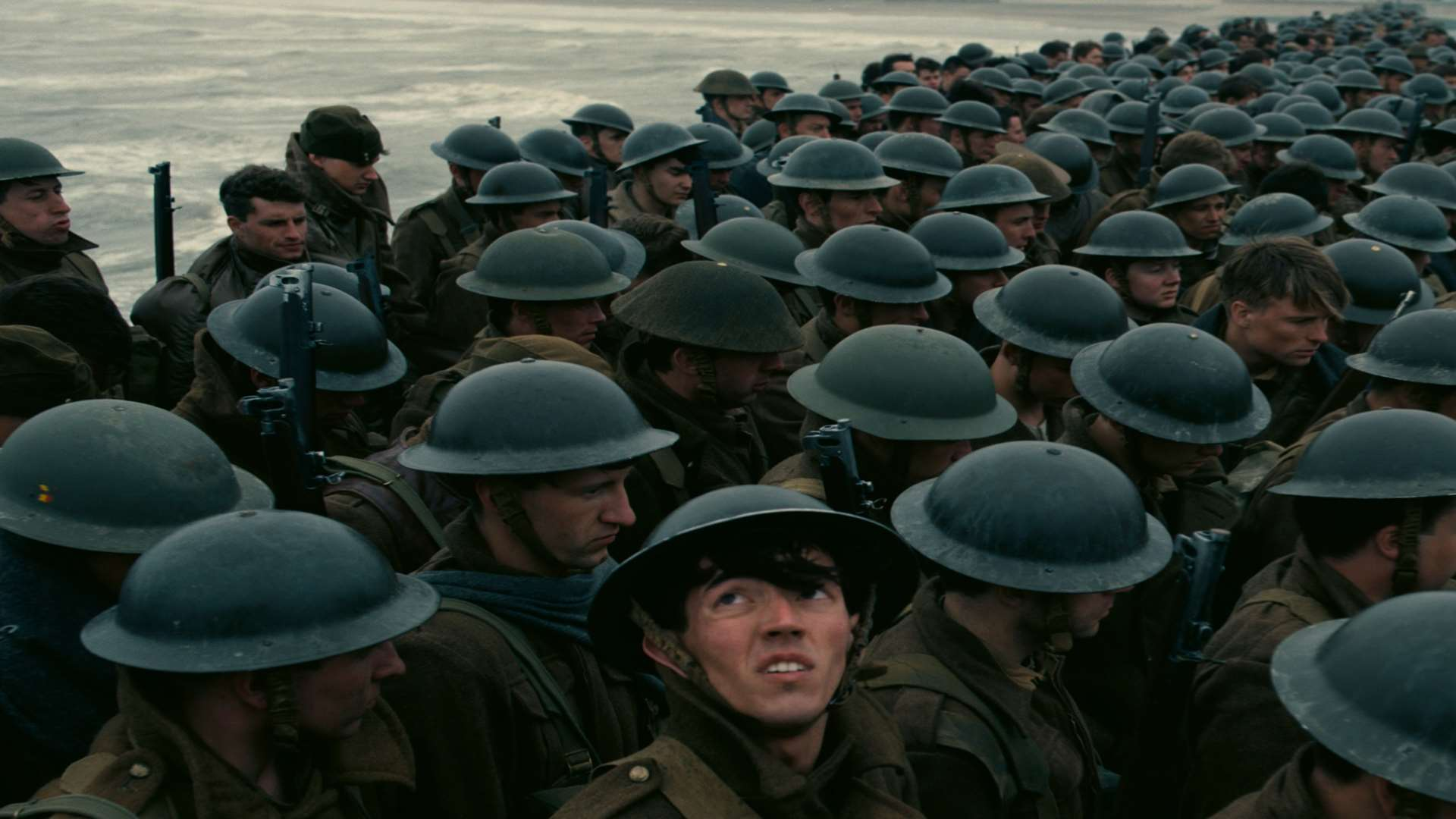 A scene from Christopher Nolan's Dunkirk as troops wait for a rescue from the East Mole of the harbour