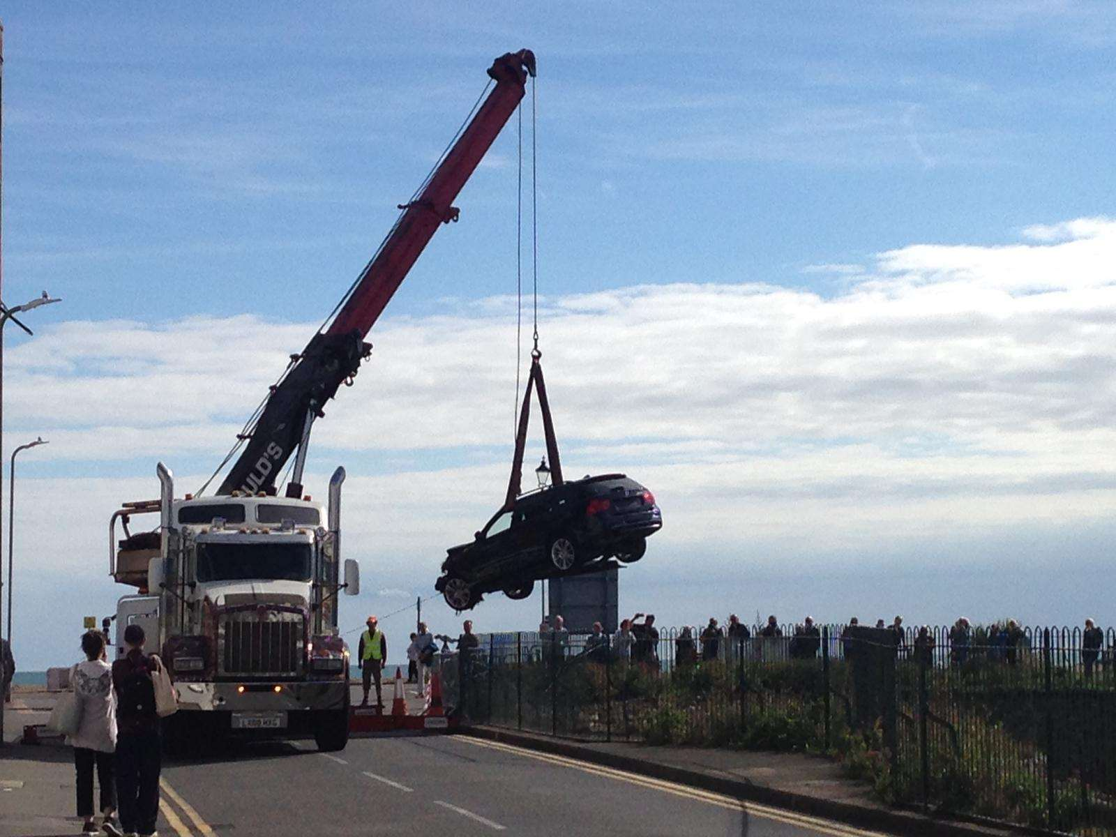 The car was hoisted out by a crane
