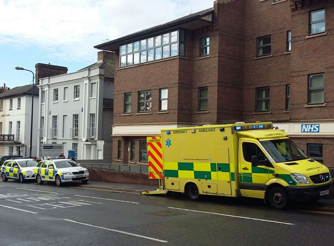 Emergency services parked outside Albion Place